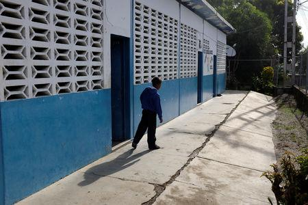 A kid walks past a classroom on the first day of school, in Caucagua, Venezuela September 17, 2018. REUTERS/Marco Bello