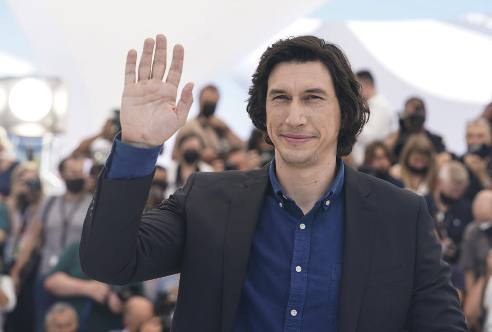 Adam Driver poses for photographers at the photo call for the film Annette at the 74th international film festival, Cannes, southern France, Tuesday, July 6, 2021. (AP Photo/Brynn Anderson)