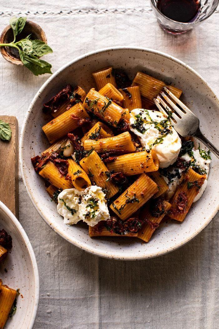 """<p>Pair this rich pasta with a bottle of red wine you've been saving for a special occasion, and treat yourselves this Valentine's Day.</p><p><strong>Get the recipe at <a href=""""https://www.halfbakedharvest.com/quick-pantry-pasta/"""" rel=""""nofollow noopener"""" target=""""_blank"""" data-ylk=""""slk:Half Baked Harvest"""" class=""""link rapid-noclick-resp"""">Half Baked Harvest</a>.</strong></p><p><strong><a class=""""link rapid-noclick-resp"""" href=""""https://www.amazon.com/Teocera-Ounce-Porcelain-Pasta-Shallow/dp/B07RFLZ554/?tag=syn-yahoo-20&ascsubtag=%5Bartid%7C10050.g.1115%5Bsrc%7Cyahoo-us"""" rel=""""nofollow noopener"""" target=""""_blank"""" data-ylk=""""slk:SHOP PASTA BOWLS"""">SHOP PASTA BOWLS</a><br></strong></p>"""