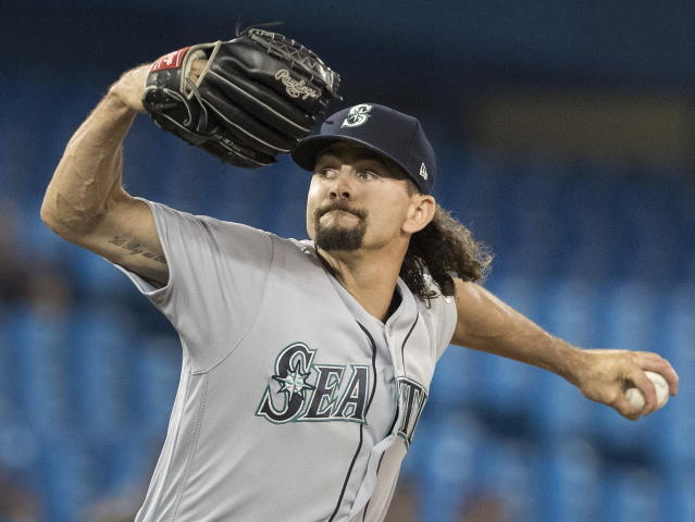 Seattle Mariners pitcher Taylor Guilbeau throws during fourth-inning baseball game action against the Toronto Blue Jays in Toronto, Saturday, Aug. 17, 2019. (Fred Thornhill/The Canadian Press via AP)