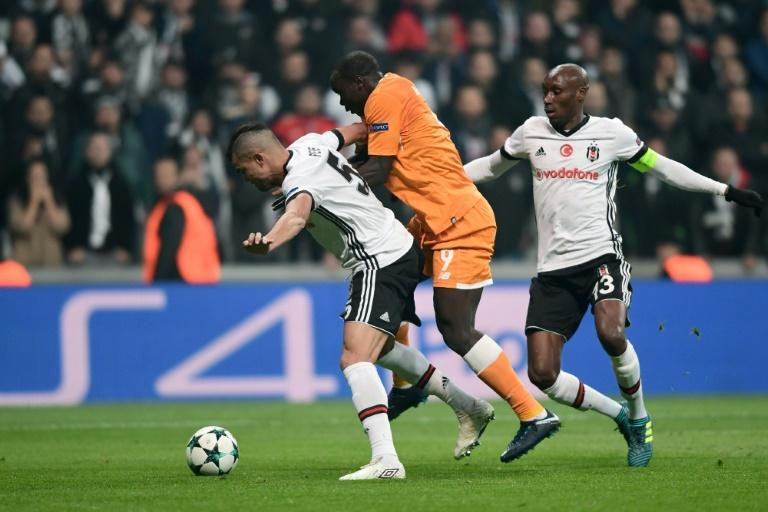 Porto's forward Vincent Aboubakar (C) vies for the ball with Besiktas' defender Pepe (L) and midfielder Atiba Hutchinson (R) during the UEFA Champions League Group G football match November 21, 2017