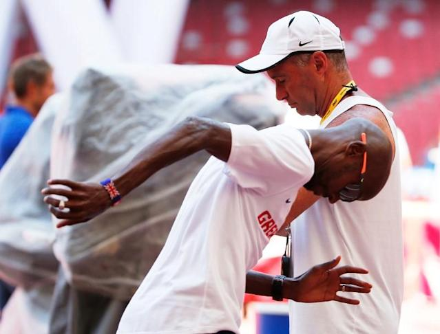 File photo of Mo Farah of Great Britain and coach Alberto Salazar in Beijing