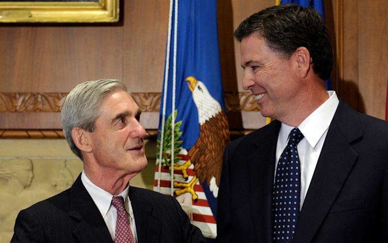 Then-incoming FBI Director James Comey talks with outgoing FBI Director Robert Mueller in 2013 - Credit: AP