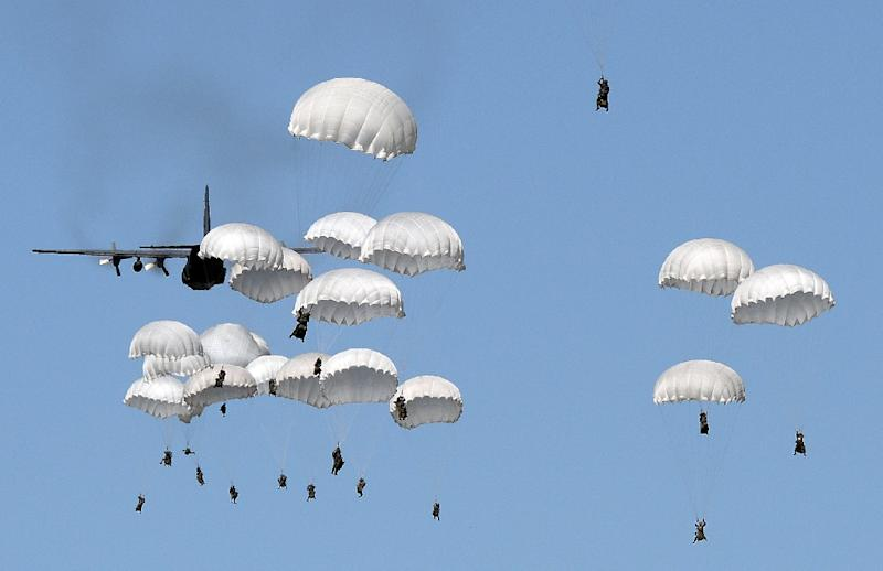 Polish troops land with parachutes at a military compound near Torun, as part of a NATO military exercise in June 2016 (AFP Photo/Janek Skarzynski)