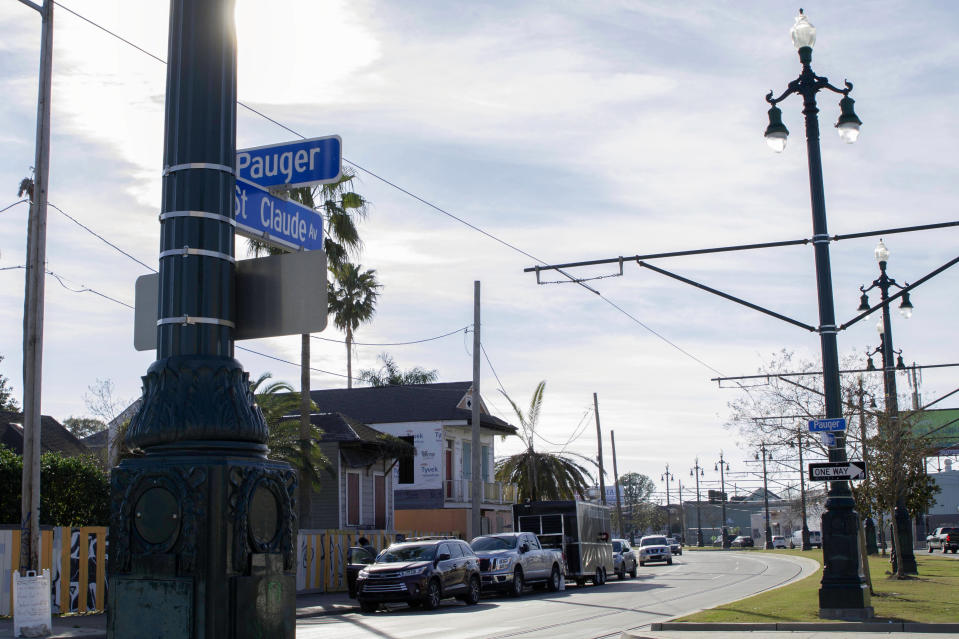 A street sign hangs on St. Claude Avenue, Jan. 30, 2021, in New Orleans. The toll of this year's toned-down Mardi Gras is evident on St. Claude Avenue, an off-the-beaten-track stretch that has become a destination in recent years. (AP Photo/Dorthy Ray)