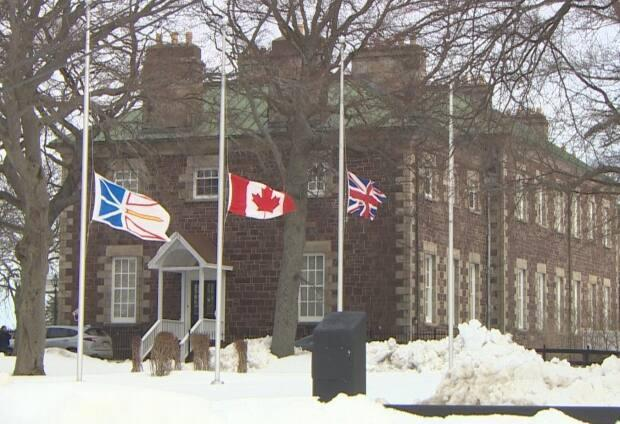 Flags at various places, including here at Government House, are lowered as part of the National Day of Observance to remember those who have died due to COVID-19.  (Curtis Hicks/CBC - image credit)