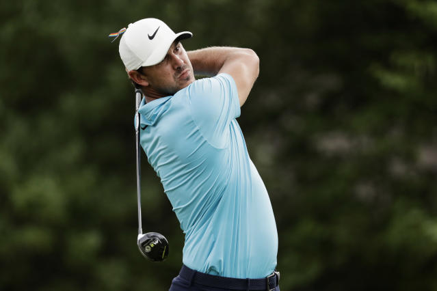 Brooks Koepka watches his tee shot on the 18th hole during the first round of the World Golf Championship-FedEx St. Jude Invitational Thursday, July 30, 2020, in Memphis, Tenn. (AP Photo/Mark Humphrey)