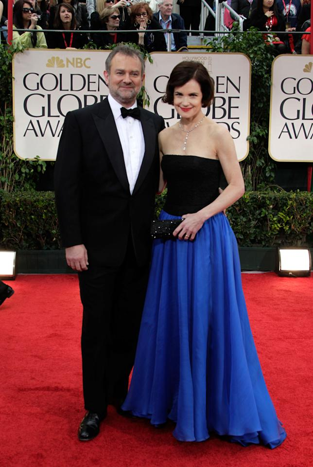 Elizabeth McGovern (R) and Hugh Bonneville arrive at the 69th Annual Golden Globe Awards in Beverly Hills, California, on January 15.