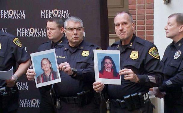PHOTO: Houston police officers hold the photos of two suspects in the shooting of five police officers during a press conference at a hospital in Houston, Jan. 19, 2019. The suspects were identified as Dennis Tuttle, 59, and Rhogena Nicholas, 58. (KTRK, FILE)