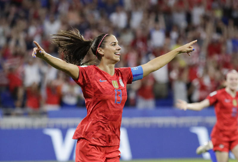 United States' Alex Morgan celebrates after scoring her side's second goal during the Women's World Cup semifinal soccer match between England and the United States, at the Stade de Lyon, outside Lyon, France, Tuesday, July 2, 2019. (AP Photo/Alessandra Tarantino)