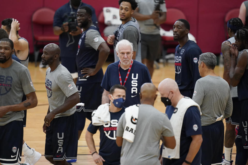 Head coach Gregg Popovich, center, coaches during practice for USA Basketball, Tuesday, July 6, 2021, in Las Vegas. (AP Photo/John Locher)