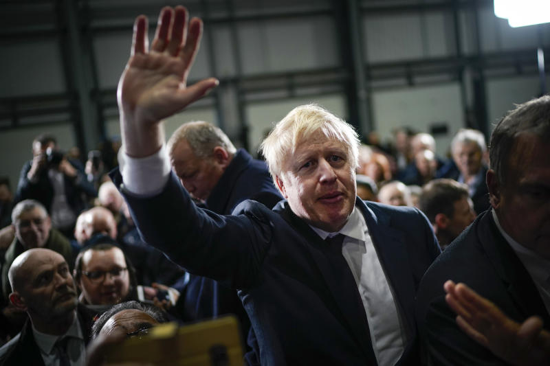 British Prime Minister Boris Johnson is applauded by supporters after speaking at the Globus Group factory on December 10, 2019 in Manchester, England. The U.K. will go to the polls in a general election on December 12. Photo: Christopher Furlong/Getty Images