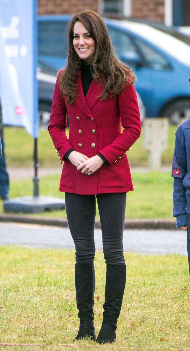 <p>The Duchess of Cambridge wears a Philosophy di Lorenzo Serafini red blazer, black turtleneck, gloves, dark wash jeans and knee-high boots while visiting RAF Wittering near Peterborough. </p>