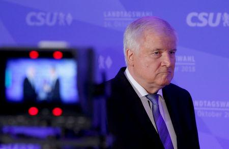 Leader of the Christian Social Union (CSU) Horst Seehofer arrives to give a speech after first exit polls in the Bavarian state election in Munich, Germany, October 14, 2018. REUTERS/Michaela Rehle