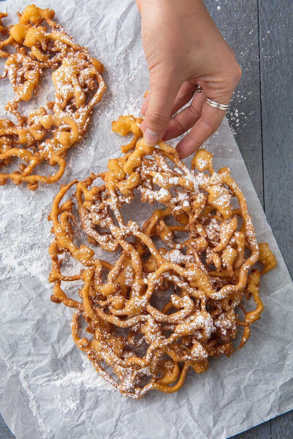 """<p>The king of state fair treats.</p><p>Get the recipe from <a href=""""https://www.delish.com/cooking/recipe-ideas/a20136641/homemade-funnel-cake-recipe/"""" rel=""""nofollow noopener"""" target=""""_blank"""" data-ylk=""""slk:Delish."""" class=""""link rapid-noclick-resp"""">Delish.</a></p><p><a class=""""link rapid-noclick-resp"""" href=""""https://www.amazon.com/Polder-THM-515-Stainless-Steel-Thermometer/dp/B001FB6IFY/?tag=syn-yahoo-20&ascsubtag=%5Bartid%7C1782.g.1631%5Bsrc%7Cyahoo-us"""" rel=""""nofollow noopener"""" target=""""_blank"""" data-ylk=""""slk:BUY NOW"""">BUY NOW</a> <strong><em>Polder Candy Thermometer, $15, amazon.com</em></strong></p>"""