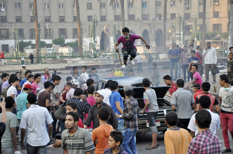 An Egyptian protester stomps on the roof of a car in Tahrir Square in Cairo, Egypt, early Saturday, Sept. 15, 2012, before police cleared the area after days of protests against a film ridiculing the Prophet Muhammad. Egyptian police on Saturday cleared out protesters who have been clashing with security forces for the past four days near the U.S. Embassy as most cities around the Muslim world reported calm a day after at least six people were killed in a wave of angry protests over an anti-Islam film.(AP Photo)