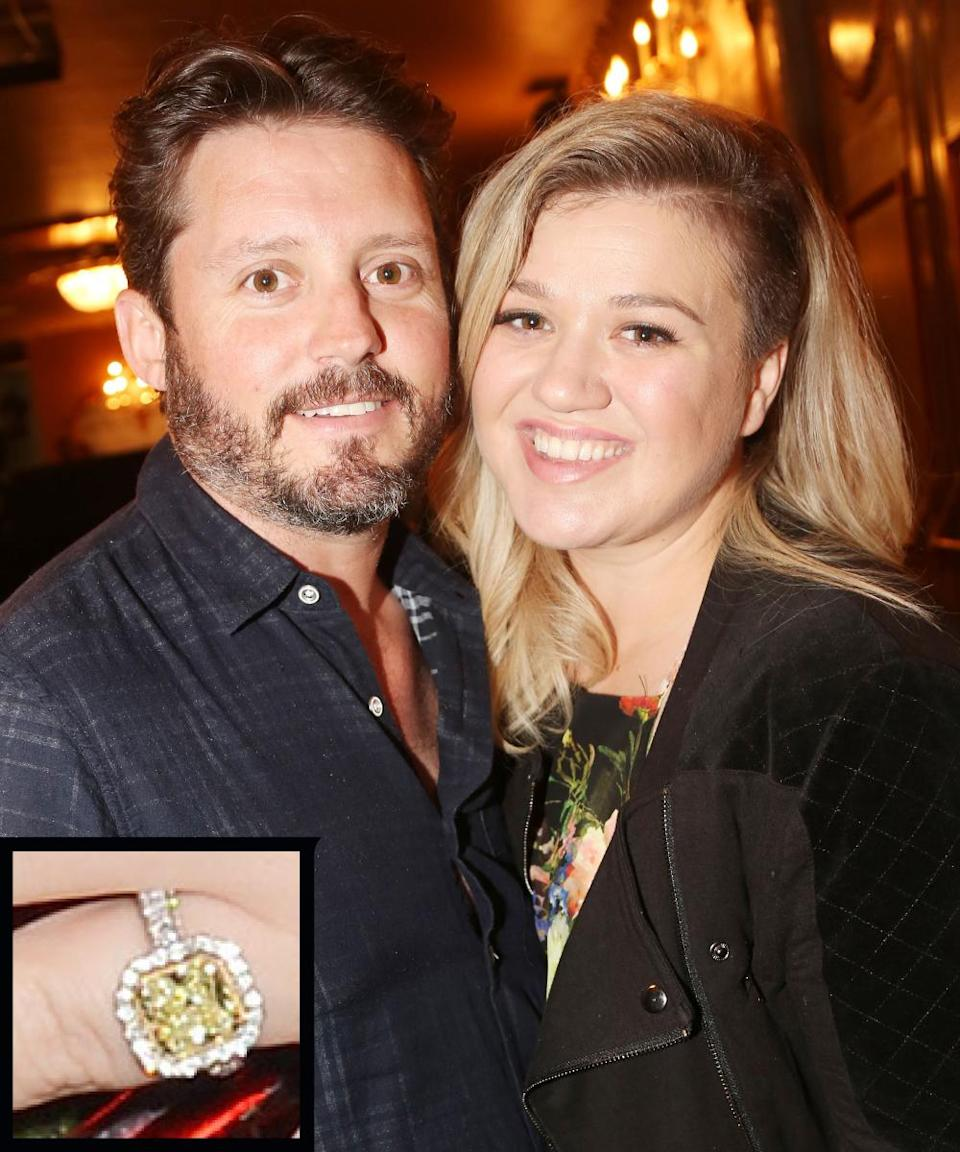 """<p>Brandon Blackstock proposed to singer Kelly Clarkson in 2012 with a huge yellow canary <a rel=""""nofollow noopener"""" href=""""http://www.instyle.com/news/kelly-clarksons-engagement-ring-see-photo"""" target=""""_blank"""" data-ylk=""""slk:diamond"""" class=""""link rapid-noclick-resp"""">diamond</a> surrounded with white diamonds, which Blackstock created with jewelry designer Johnathon Arndt. </p>"""