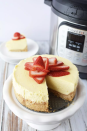 """<p>For all you fans of a classic strawberry cheesecake, here's another delightful recipe you can easily make in your Instant Pot. </p><p><em><a href=""""https://www.momdot.com/instant-pot-cheesecake-recipe/"""" rel=""""nofollow noopener"""" target=""""_blank"""" data-ylk=""""slk:Get the recipe from MomDot »"""" class=""""link rapid-noclick-resp"""">Get the recipe from MomDot »</a></em></p>"""