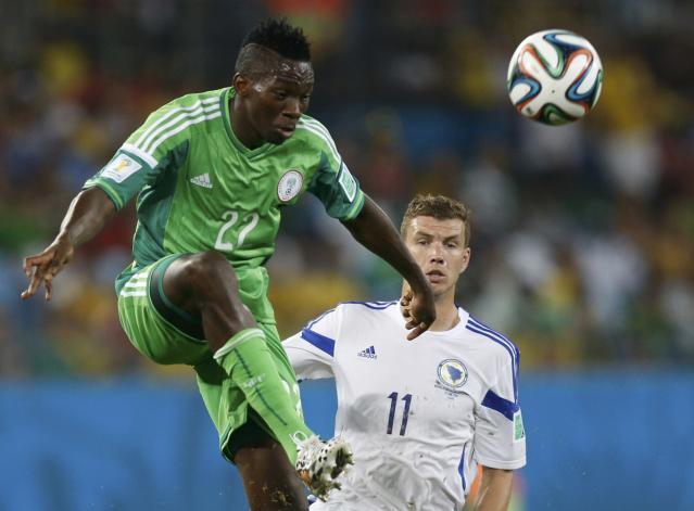 Nigeria's Kenneth Omeruo kicks the ball infront of Bosnia's Edin Dzeko during their 2014 World Cup Group F soccer match at the Pantanal arena in Cuiaba June 21, 2014. REUTERS/Ueslei Marcelino (BRAZIL - Tags: SOCCER SPORT WORLD CUP TPX IMAGES OF THE DAY)
