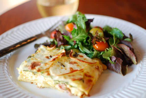 "<strong>Get the recipe for <a href=""http://food52.com/recipes/526-frittata-with-prosciutto-potatoes-goat-cheese-thyme"" rel=""nofollow noopener"" target=""_blank"" data-ylk=""slk:frittata with prosciutto, potatoes, goat cheese and thyme"" class=""link rapid-noclick-resp"">frittata with prosciutto, potatoes, goat cheese and thyme</a> by formerchef via Food52.</strong>"