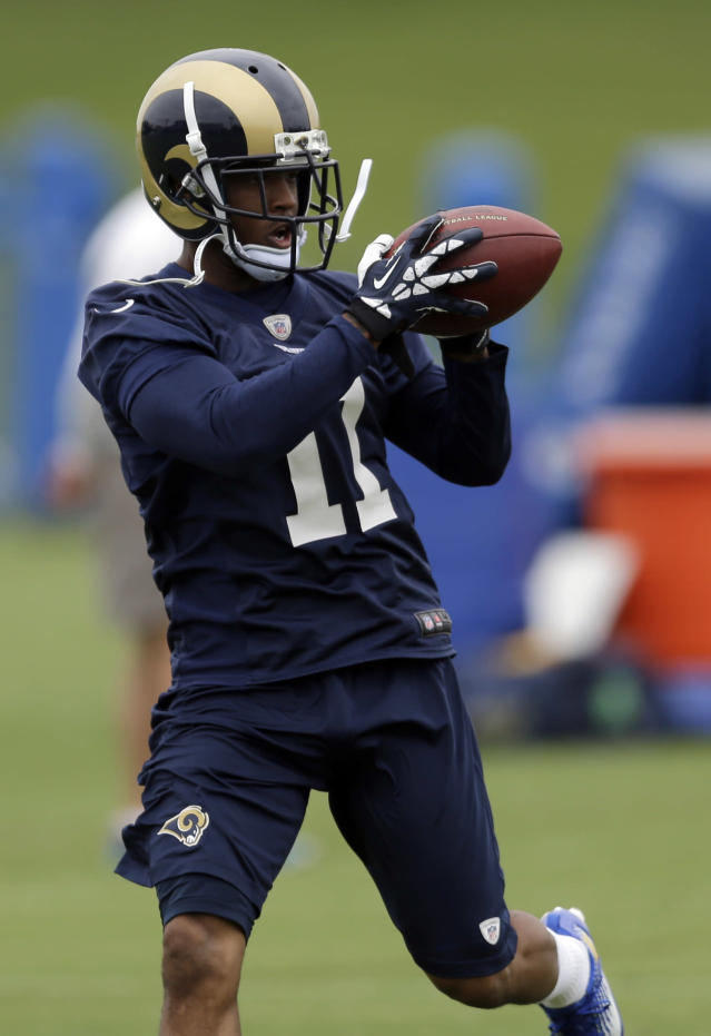 FILE - In this June 5, 2014 file photo, St. Louis Rams wide receiver Tavon Austin catches a pass during an organized team activity at the NFL football team's practice facility in St. Louis. Entering Year 2, the eighth overall pick of the 2013 draft realizes there's more to the job than simply outrunning defenders(AP Photo/Jeff Roberson, File)