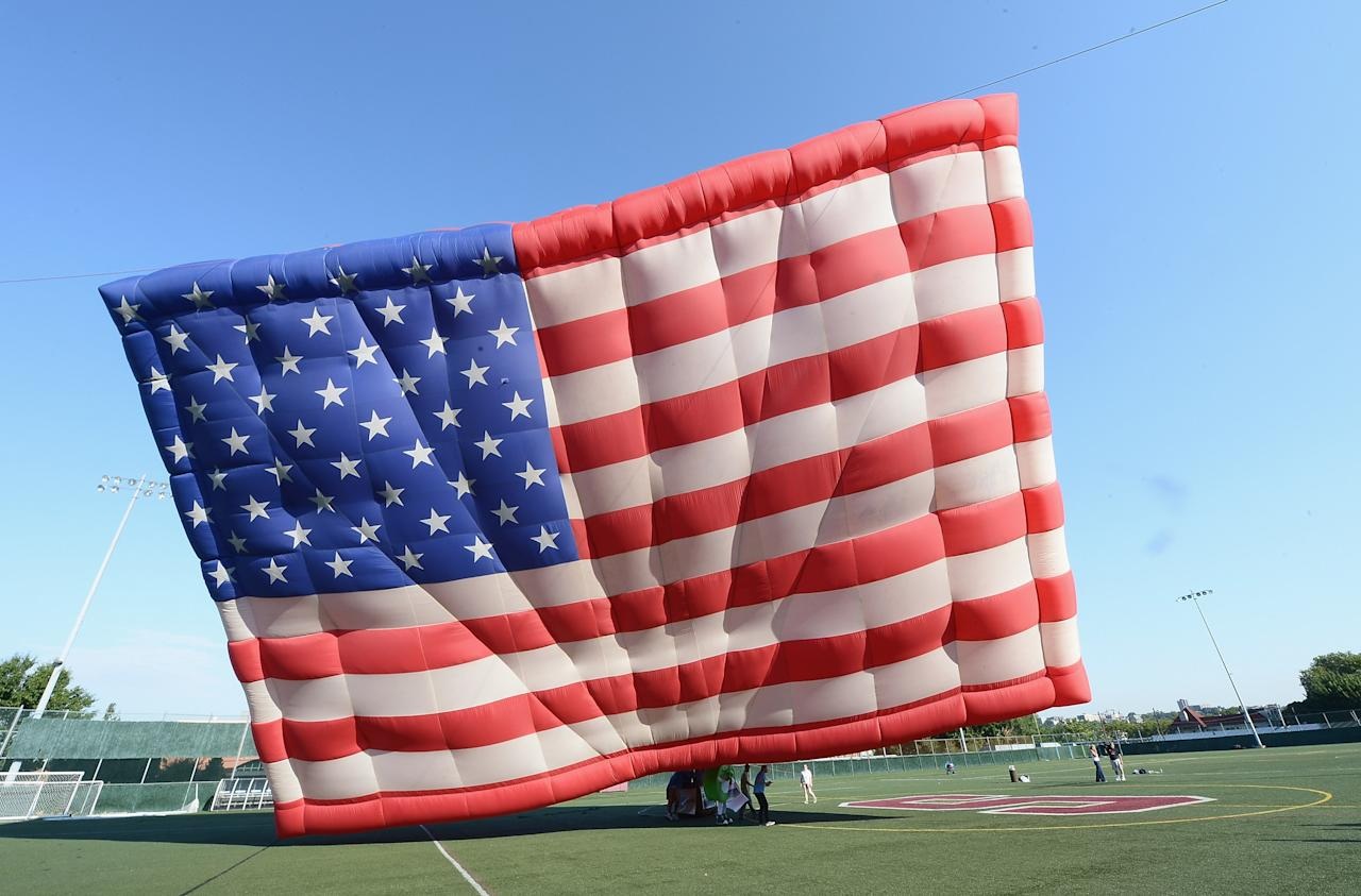 The PNC American Flag balloon is inflated in honor of America for Independence Day on the De Baun Athletic Complex at Stevens Institute of Technology on July 3, 2012 in Hoboken, New Jersey. The 53 by 78 foot balloon is the world's largest free-flying American flag, weighs 530 pounds and is being flown in the upcoming 30th annual NJ Festival of Ballooning. (Photo by Michael Loccisano/Getty Images)