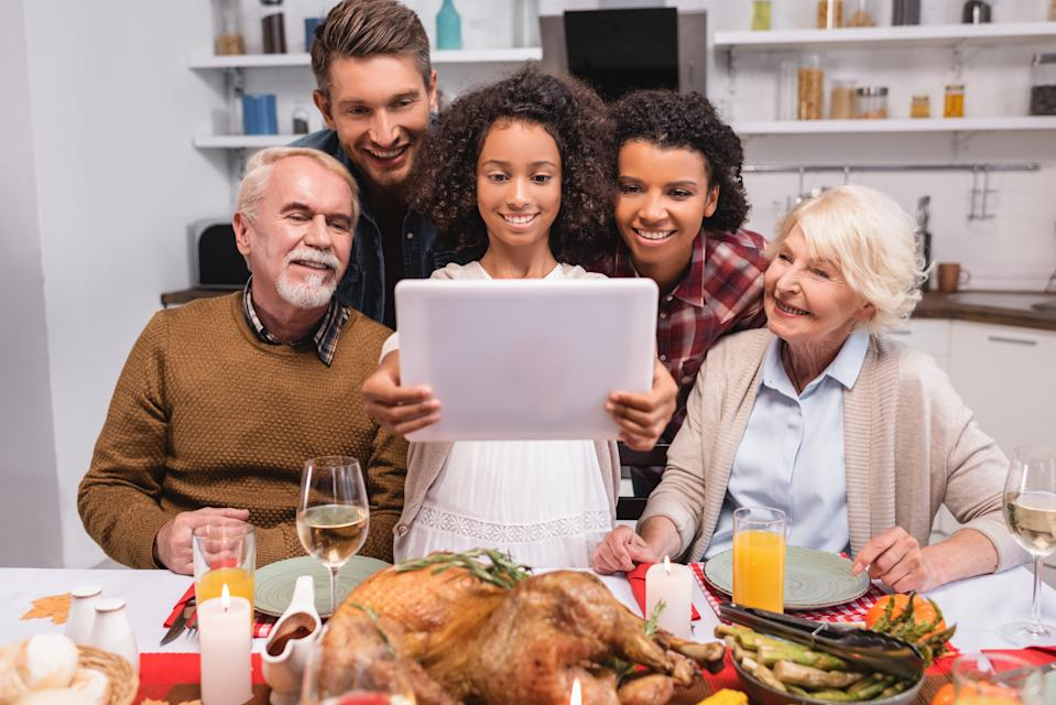 Scaled-down versions of November's biggest holiday for many families means breaking bread with loved ones over video conferencing instead. (Photo: Getty)