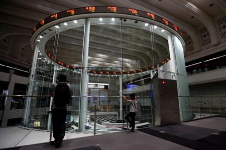 Global Markets: Asia stocks firm as Fed props up rate cut expectations