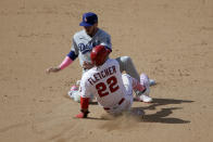 Los Angeles Angels' David Fletcher (22) steals second as the ball get by Los Angeles Dodgers second baseman Gavin Lux during the eight inning of a baseball game in Anaheim, Calif., Sunday, May 9, 2021. Fletcher went on to third. (AP Photo/Alex Gallardo)