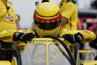 Helio Castroneves, of Brazil, climbs into his car during a practice session for the Indianapolis 500 auto race at Indianapolis Motor Speedway, Wednesday, Aug. 12, 2020, in Indianapolis. (AP Photo/Darron Cummings)