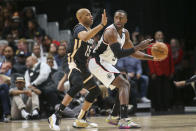 Atlanta Hawks guard Vince Carter (15) defends Los Angeles Clippers forward Patrick Patterson (54) in the first half of an NBA basketball game Wednesday, Jan. 22, 2020, in Atlanta, Ga. (AP Photo/Brett Davis)