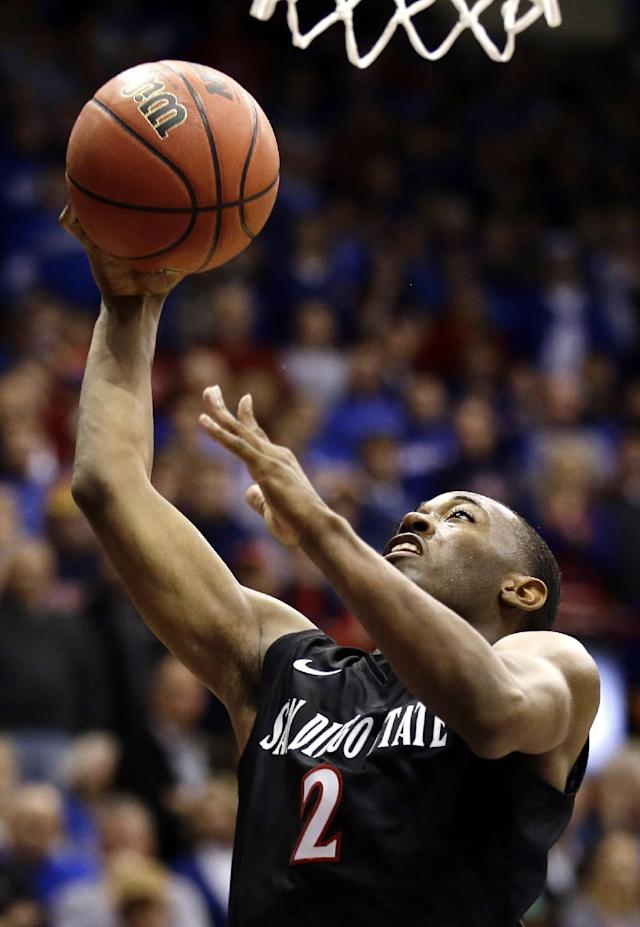 San Diego State's Xavier Thames shoots during the second half of an NCAA college basketball game against Kansas, Sunday, Jan. 5, 2014, in Lawrence, Kan. San Diego State won 61-57.(AP Photo/Charlie Riedel)