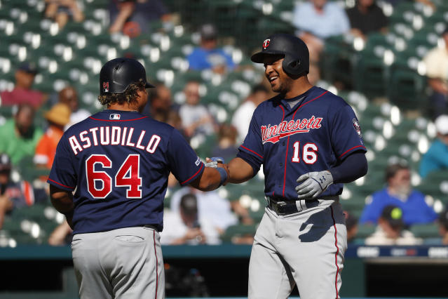 Minnesota Twins' Jonathan Schoop (16) celebrates his two-run home run with Willians Astudillo (64) during the seventh inning of a baseball game against the Detroit Tigers in Detroit, Thursday, Sept. 26, 2019. (AP Photo/Paul Sancya)