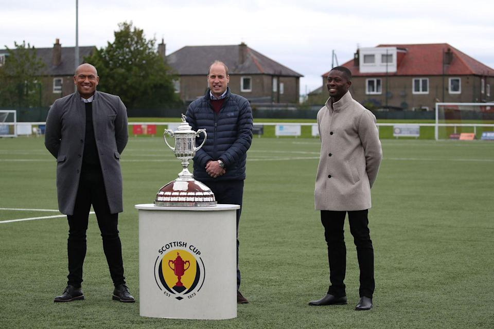 <p>Posing next to the Scottish Cup during a visit to Spartans FC's Ainslie Park Stadium on May 21, 2021 in Edinburgh, Scotland.</p>
