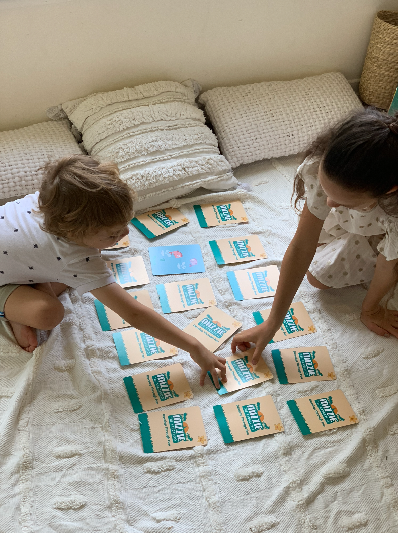 A young boy and girl playing the Mizzie The Kangaroo memory card game
