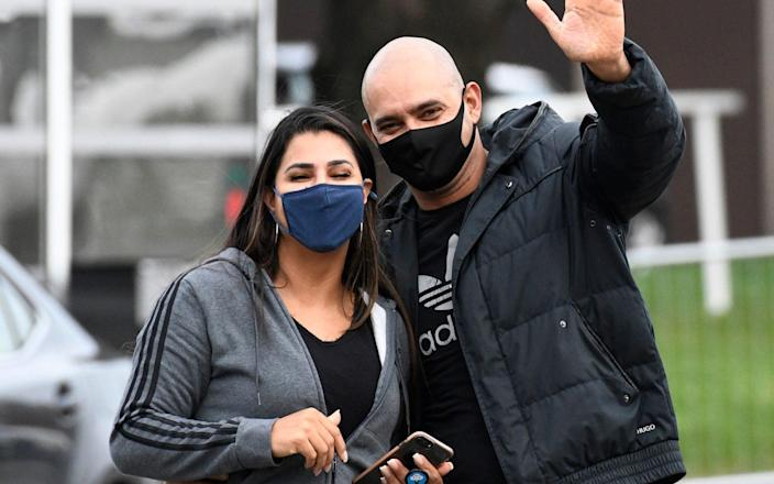 Wagner Araujo, acompanied by his wife Elaine take in some fresh air and exercise in the car park of the Radisson Blu Hotel during their ten day period of self isolation after arriving in the UK from Brazil - David Dyson