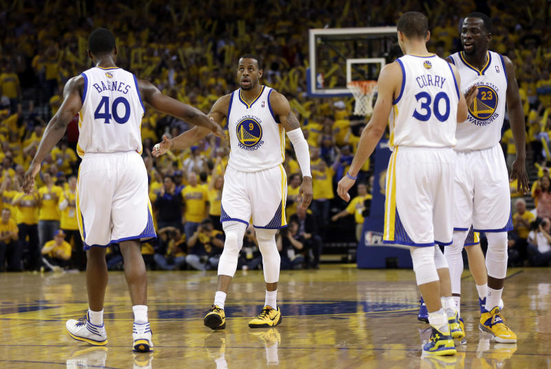 Golden State Warriors' Andre Iguodala (9) celebrates with teammates after scoring and getting fouled during the second half in Game 6 of an opening-round NBA basketball playoff series against the Los Angeles Clippers on Thursday, May 1, 2014, in Oakland, Calif. Golden State won 100-99. (AP Photo/Marcio Jose Sanchez)