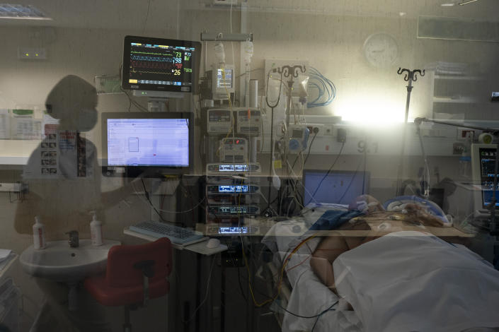 A COVID-19 patient undergoes treatment at a hospital in Badalona, Spain, on April 1. (Felipe Dana/AP)