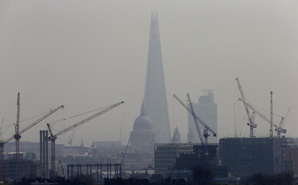 Building construction cranes frame The Shard, western Europe's tallest building, and St Paul's Cathedral in London. Photo: Suzanne Plunkett/Reuters
