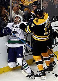 Things got a little out of hand in the third period, including a finger-wagging incident between Boston's Milan Lucic and Vancouver's Alex Burrows (L)