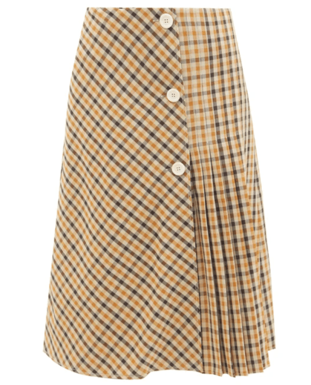 """<p>Wales Bonner Kalimba Checked Pleated Wool-blend Skirt, $860, <a href=""""https://rstyle.me/+bVcTBDQqMFk5QpQnaHCN8Q"""" rel=""""nofollow noopener"""" target=""""_blank"""" data-ylk=""""slk:available here"""" class=""""link rapid-noclick-resp"""">available here</a> (sizes IT 38-46)</p>"""