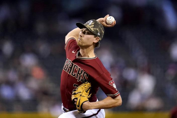 Arizona Diamondbacks starting pitcher Luke Weaver throws a pitch against the Washington Nationals during the first inning of a baseball game Sunday, May 16, 2021, in Phoenix. (AP Photo/Ross D. Franklin)