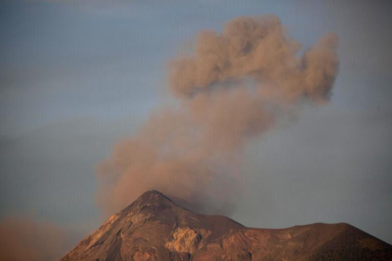Volcan de Fuego or Volcano of Fire blows outs a thick cloud of ash as seen from Antigua Guatemala, Friday, Sept. 14, 2012. The volcano spewed rivers of bright orange lava down its flanks on Thursday. Authorities ordered more than 33,000 people from nearby communities evacuated. (AP Photo/Moises Castillo)