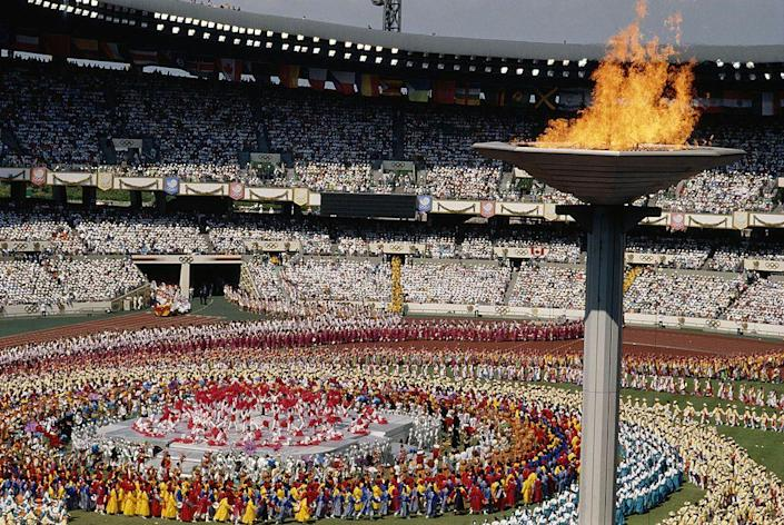 <p>The last, as of now, opening ceremony to take place during the daytime featured skydivers and even a mass demonstration of taekwondo. The ceremony is best known, unfortunately, for the peace doves that came to rest on the cauldron as it was lit.</p>