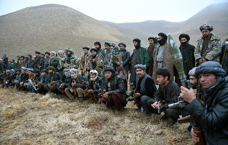 The government's reliance on militias to help fight the Taliban represents a complete departure from previous efforts to disarm these groups (AFP Photo/Wakil Kohsar)