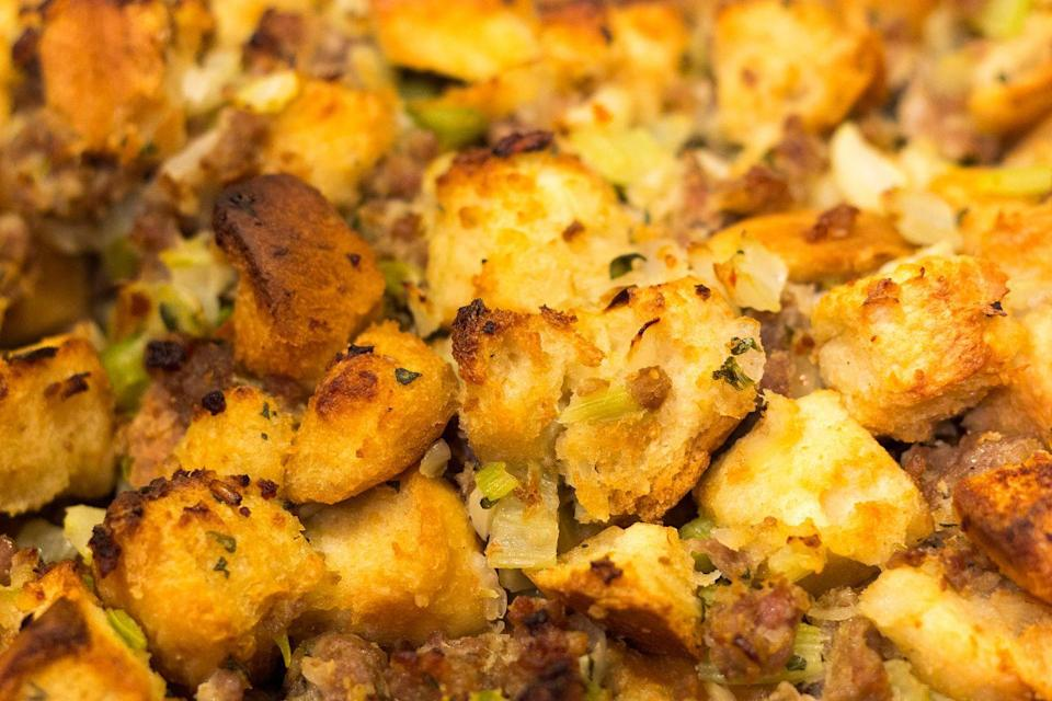 """<p>Whether you refer to it as stuffing or dressing, or you serve it inside the turkey or outside, one thing is for sure: you probably have it every year. We don't know if the Pilgrims had it, but <a href=""""https://www.history.com/news/stuffing-dressing-and-filling-thanksgiving-across-america"""" rel=""""nofollow noopener"""" target=""""_blank"""" data-ylk=""""slk:History.com"""" class=""""link rapid-noclick-resp"""">History.com</a> points out that it's very likely that the first Thanksgivings included some sort of wild game served with wild rice. As the years went by, New Englanders added chestnuts, Bostonians made oyster-based recipes, and Southerners used cornbread as a base. </p>"""