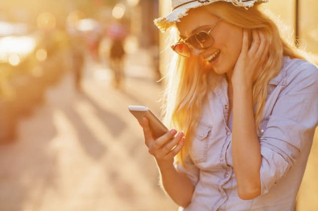 Close up of a young woman looking at mobile phone