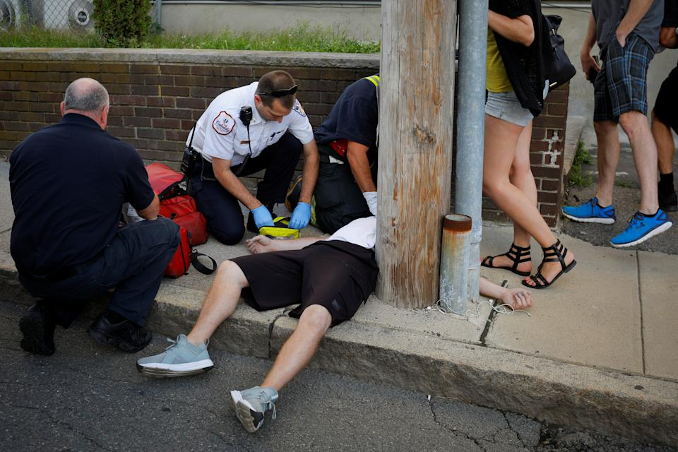 """Cataldo Ambulance medics and other first responders revive a 32-year-old man who was found unresponsive and not breathing after an opioid overdose on a sidewalk in the Boston suburb of Everett, Massachusetts, U.S., August 23, 2017. REUTERS/Brian Snyder  SEARCH """"SNYDER OPIOIDS"""" FOR THIS STORY. SEARCH """"WIDER IMAGE"""" FOR ALL STORIES.  TPX IMAGES OF THE DAY."""
