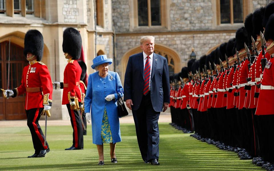 Former US president Donald Trump with Queen Elizabeth II at Windsor Castle, inspecting the Guard of Honour - Pablo Martinez Monsivais/AP