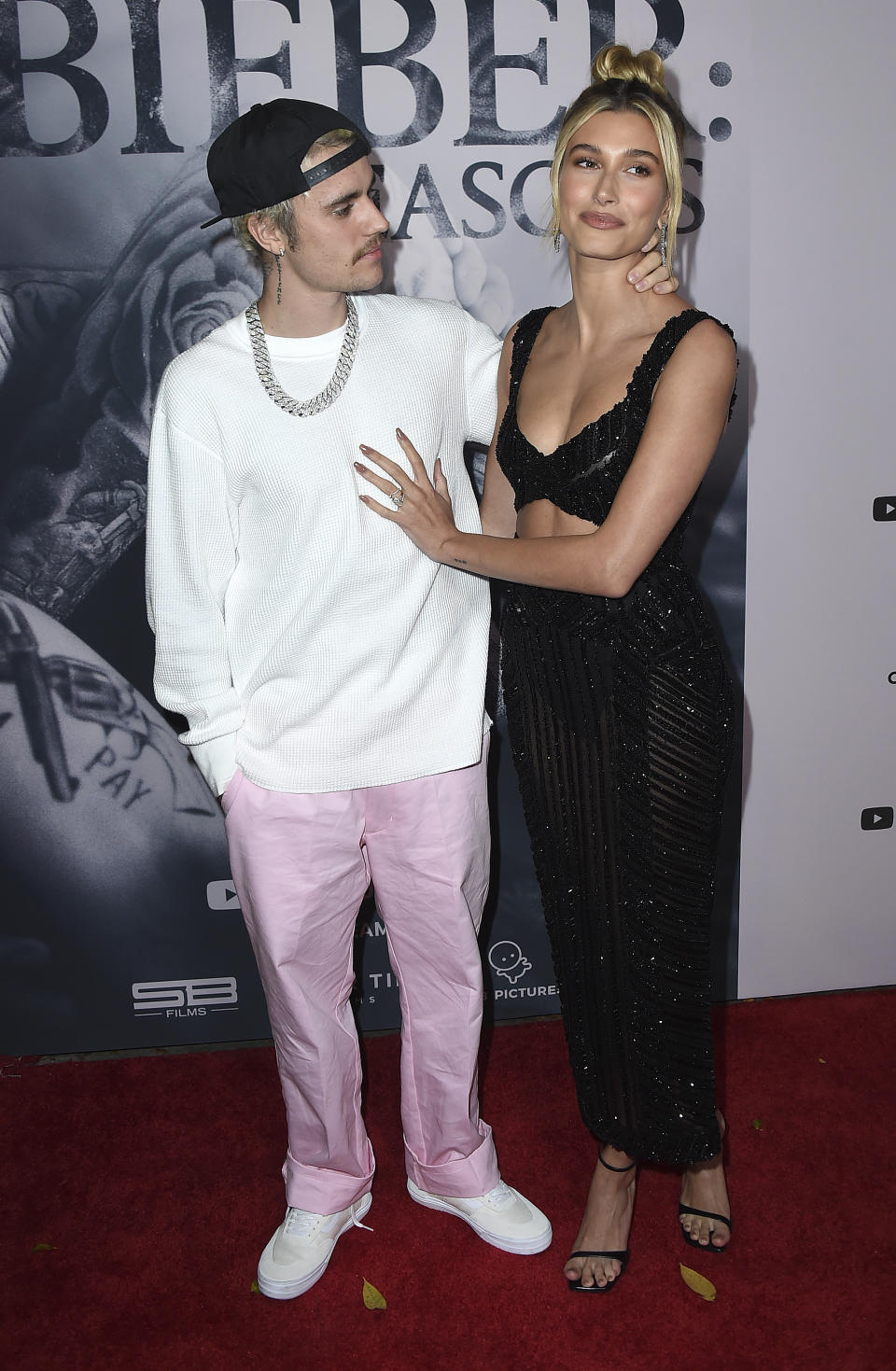 """Justin Bieber and Hailey Bieber arrive at the Los Angeles premiere of """"Justin Bieber: Seasons"""" on Monday, Jan. 27, 2020. (Photo by Jordan Strauss/Invision/AP)"""